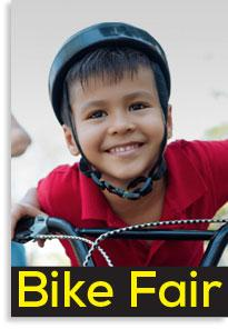 Image of child wearing a helmet on a Bike